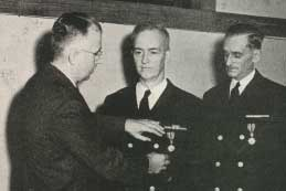 Ralph E. Jamieson receives DSM medal while William R. Rudolph looks on