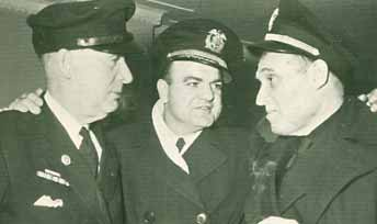 Walter Morrison, Chief Engineer, SS Stella Lykes; R. M. Peterson (affiliation unknown) Captain S. Charles Wallace