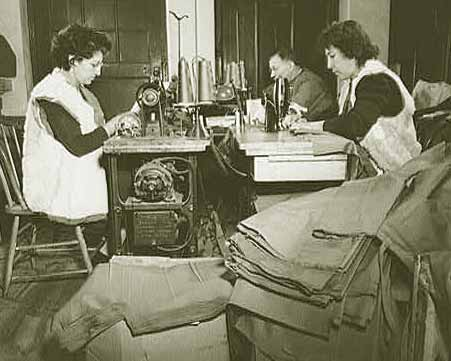 Workers stitching heavy cotton exterior of vests